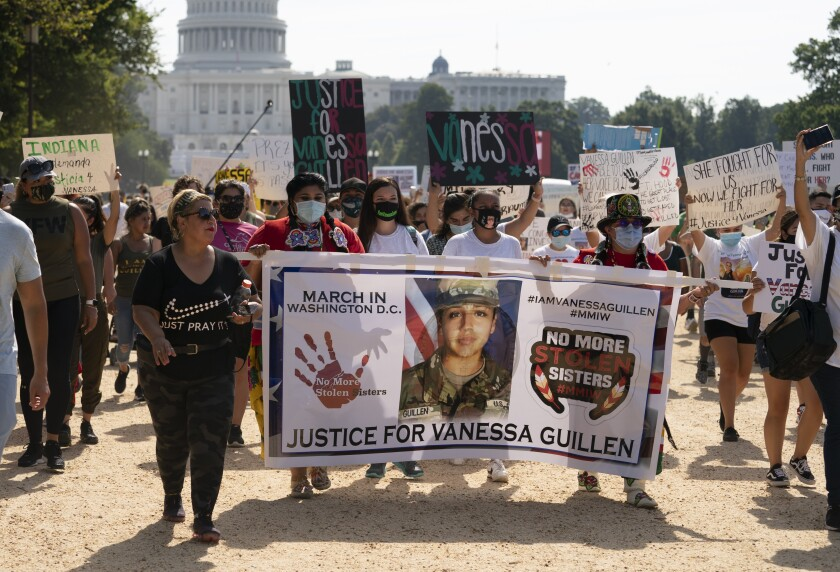Supporters of the family of slain Army Spc. Vanessa Guillen march to the White House along the National Mall as Capitol Hill is seen in the distance after a news conference, Thursday, July 30, 2020, in Washington. (AP Photo/Carolyn Kaster)