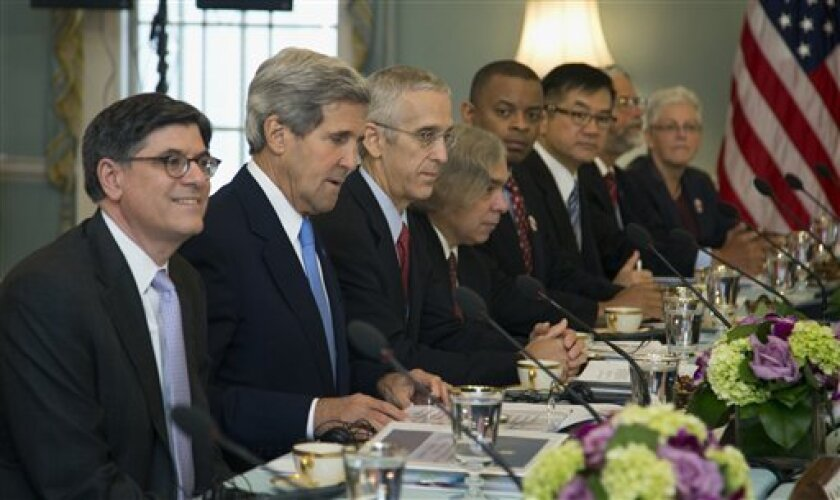 Treasury Secretary Jacob Lew, left, Secretary of State John Kerry, second from left, and others, participate in the Joint Session on Climate Change with Chinese delegation headed by Chinese Vice Premier Wang Yang, and China's State Councilor Yang Jiechi, Wednesday, July 10, 2013, in the Thomas Jeff