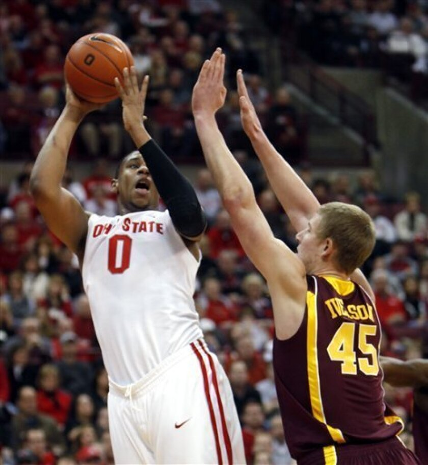 Ohio State's Jared Sullinger (0) shoots over Minnesota's Colton Iverson (45) during the first half of an NCAA college basketball game Sunday, Jan. 9, 2011, in Columbus, Ohio. (AP Photo/Terry Gilliam)