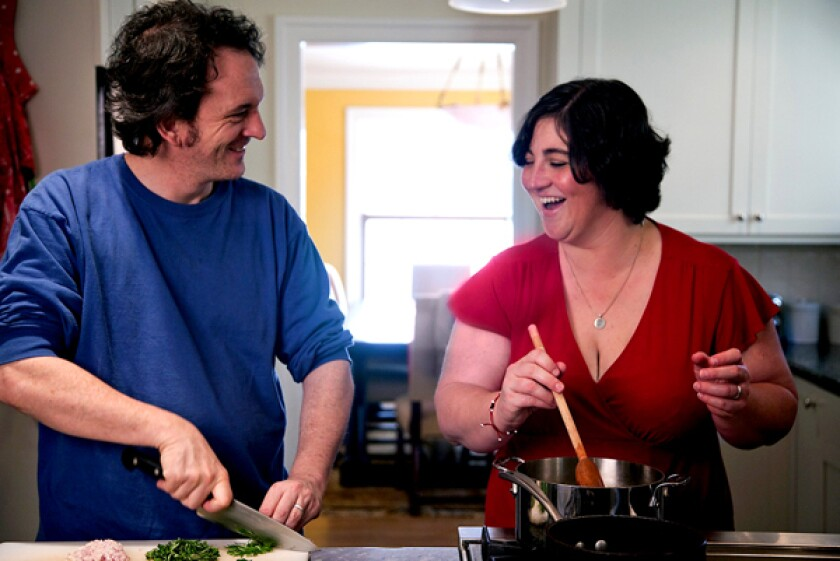Shauna James Ahern, known as Gluten-Free Girl, cooks with husband Danny Ahern in their kitchen in Washington state.