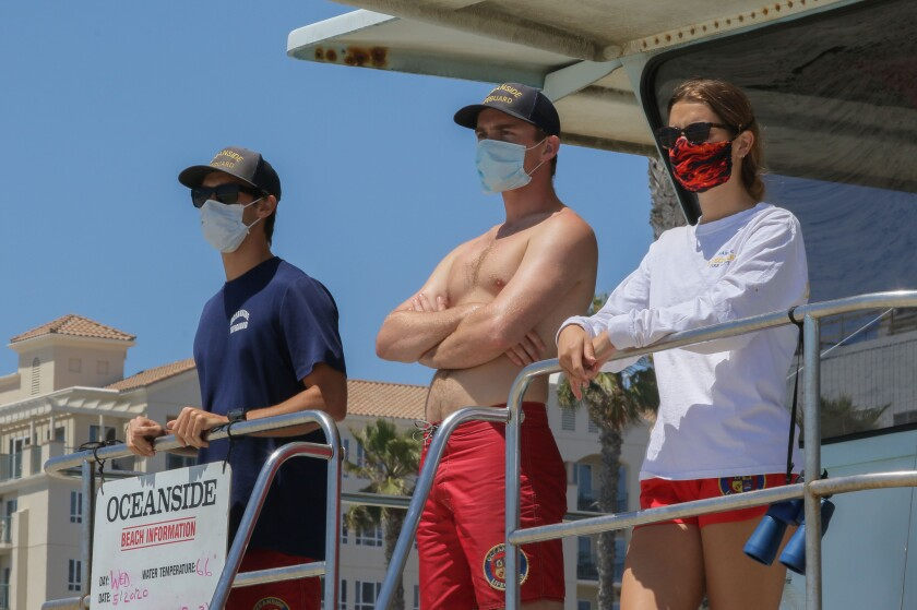 Seasonal lifeguards keep an eye on the water at Tower 1 in Oceanside on May 20.