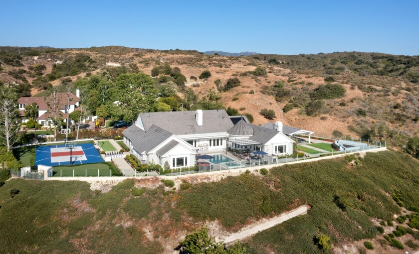 The two-acre spread includes a 5,500-square-foot home, a basketball court, a cabana, a putting green, a pool and a fire pit.