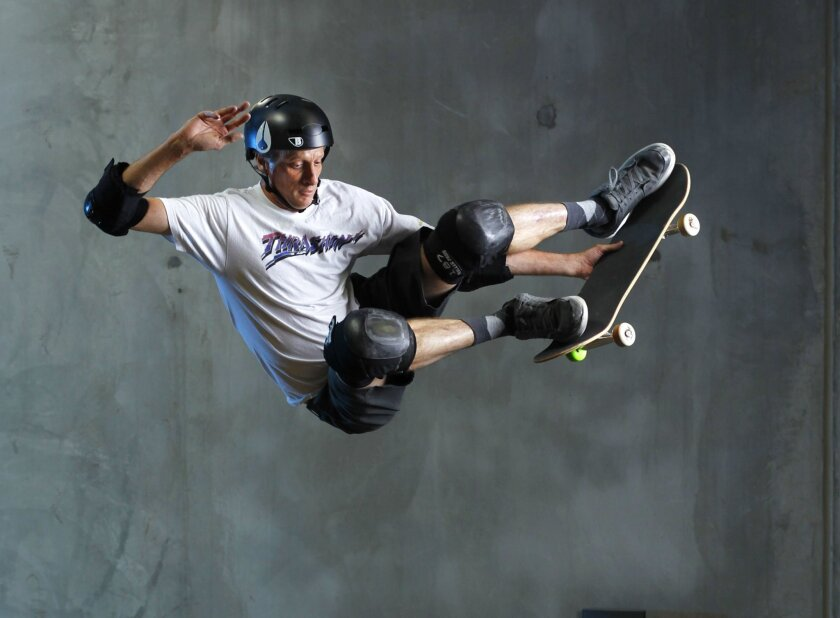 Tony Hawk demonstrates a move at his private half pipe in a Vista warehouse that is home to Tony Hawk Inc. / photo by K.C. Alfred * U-T