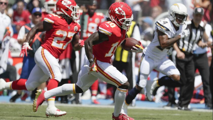 Kansas City Chiefs receiver Tyreek Hill streaks past Chargers defenders for a 58-yard touchdown catch and run from quarterback Patrick Mahomes in the first quarter at StubHub Center on Sunday.