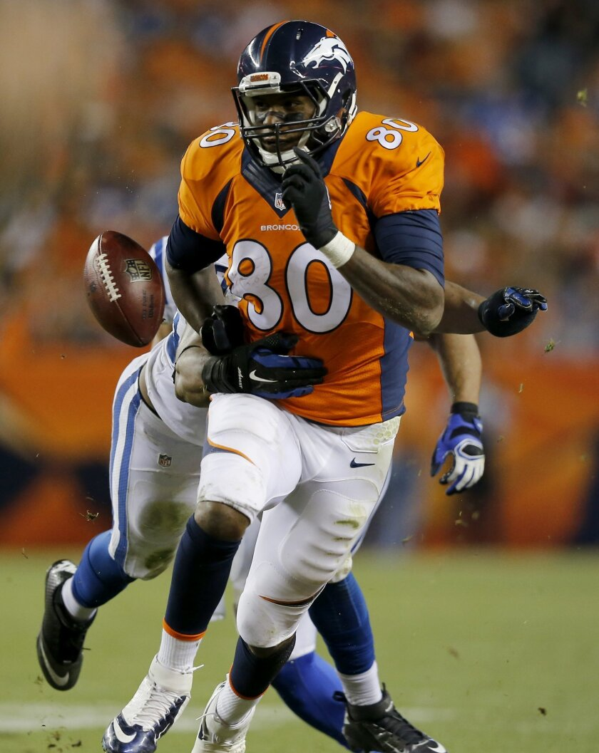 Denver Broncos tight end Julius Thomas (80) has the ball knocked free by Indianapolis Colts inside linebacker Jerrell Freeman, rear, during the second half of an NFL football game, Sunday, Sept. 7, 2014, in Denver. (AP Photo/Jack Dempsey)