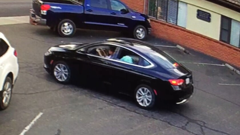 The black 2015 Chrysler 200 that the pair are believed to be in.
