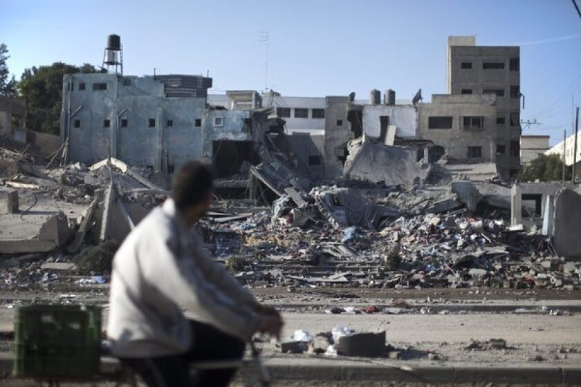A Palestinian man surveys the ruins of a Hamas police station destroyed by an Israeli airstrike in Gaza City on Tuesday. The weeklong clash has diverted attention from other Middle East conflicts and put existing alliances under pressure.