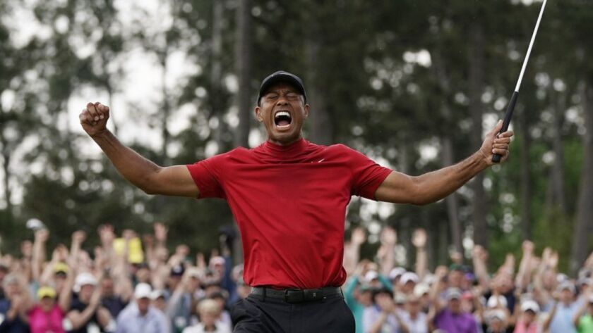 FILE - In this Sunday, April 14, 2019, file photo, Tiger Woods reacts as he wins the Masters golf to