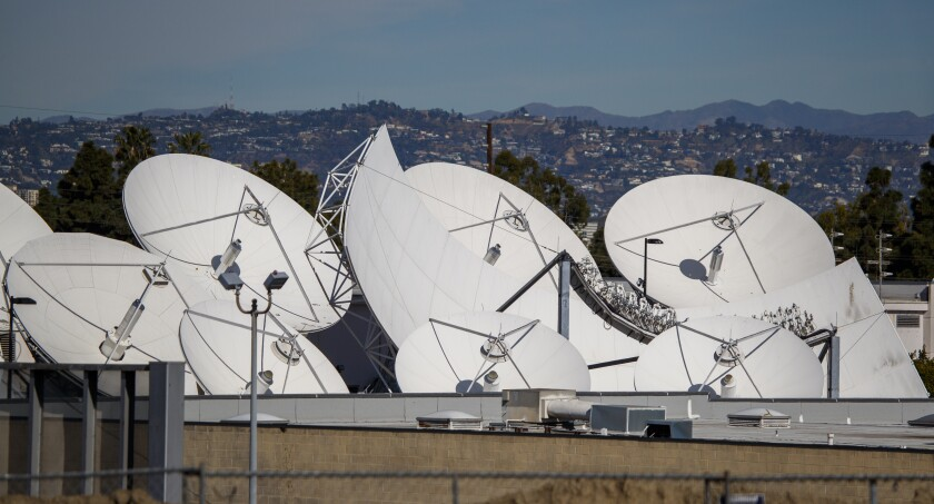 DirecTV satellite dishes at AT&T's Los Angeles Broadcast Center in Culver City last month.