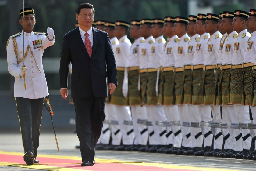 Chinese President Xi Jinping inspects the Royal Malay Regiment Guard of Honor during a welcoming ceremony at the parliament in Kuala Lumpur.