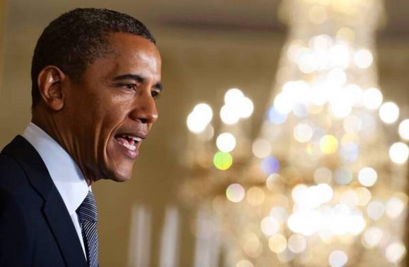Obama draws line in tax debate