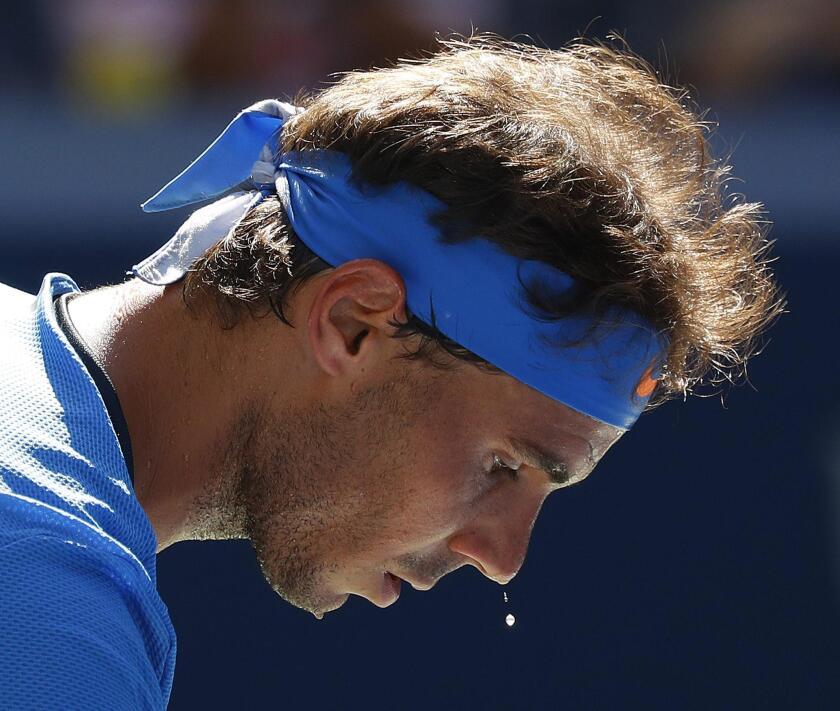 NEW14. FLUSHING MEADOWS (EE.UU.), 29/08/2016.Rafael Nadal en acción ante Denis Istomin de Uzbekistán hoy, lunes 29 de agosto de 2016, durante el primer día del Abierto de Tenis de EE.UU. en el Centro Nacional de Tenis USTA en Flushing Meadows, Nueva York (EE.UU.). El campeonato se llevará a cabo hasta el 11 de septiembre de 2016. EFE/PETER FOLEY ** Usable by HOY and SD Only **