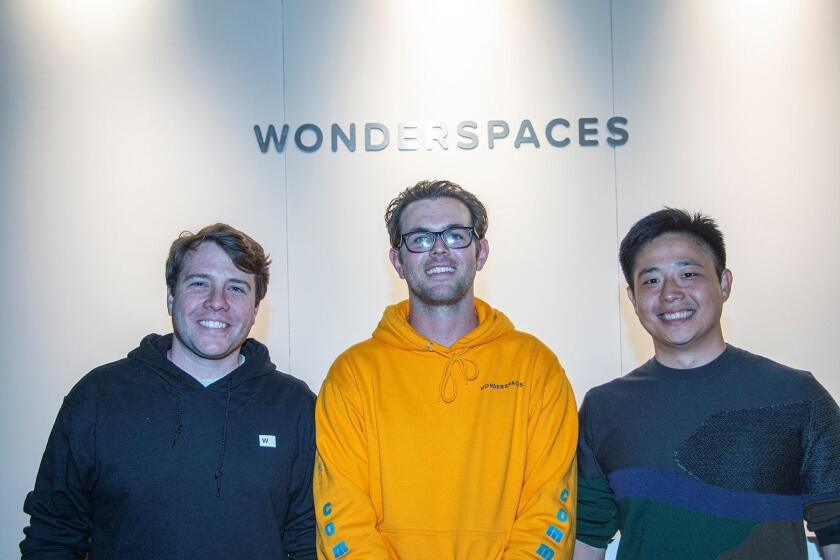 At the June 6th preview of Wonderspaces 2019, co-founders Patrick Charles and Jason Shin pose with Jordan Hill, general manager of their 100-person San Diego team, between them.