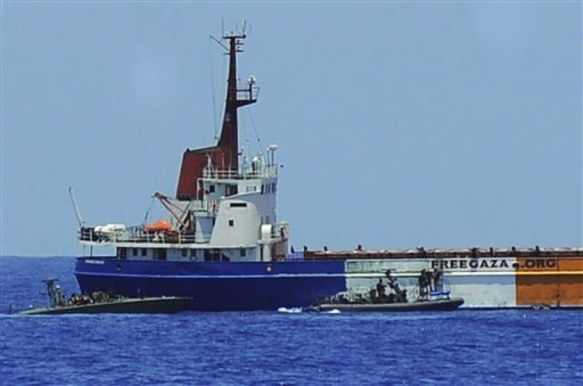 In this image made from video released by the Israeli Defense Force on Saturday, June 5, 2010, Israeli army and navy soldiers on boats are seen approaching the Gaza-bound 1,200-ton Rachel Corrie aid ship. Israeli forces seized the Gaza-bound aid vessel swiftly and without meeting resistance, preventing it from breaking a naval blockade of the Hamas-ruled territory days after a similar effort turned bloody. (AP Photo/Israeli Defense Forces) AP HAS NO WAY OF INDEPENDENTLY VERIFYING THE AUTHENTICITY OF THE VIDEO PROVIDED BY THE ISRAELI DEFENSE FORCE. NO SALES.
