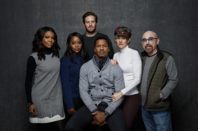 """PARK CITY, UTAH -- MONDAY, JANUARY 25, 2016: Gabrielle Union, from left, Aja Naomi King, Armie Hammer, Nate Parker, director, Penelope Ann Miller and Jackie Earle Haley, from the film, """"The Birth of A Nation, """" in the L.A. Times photo & video studio at the Sundance Film Festival."""