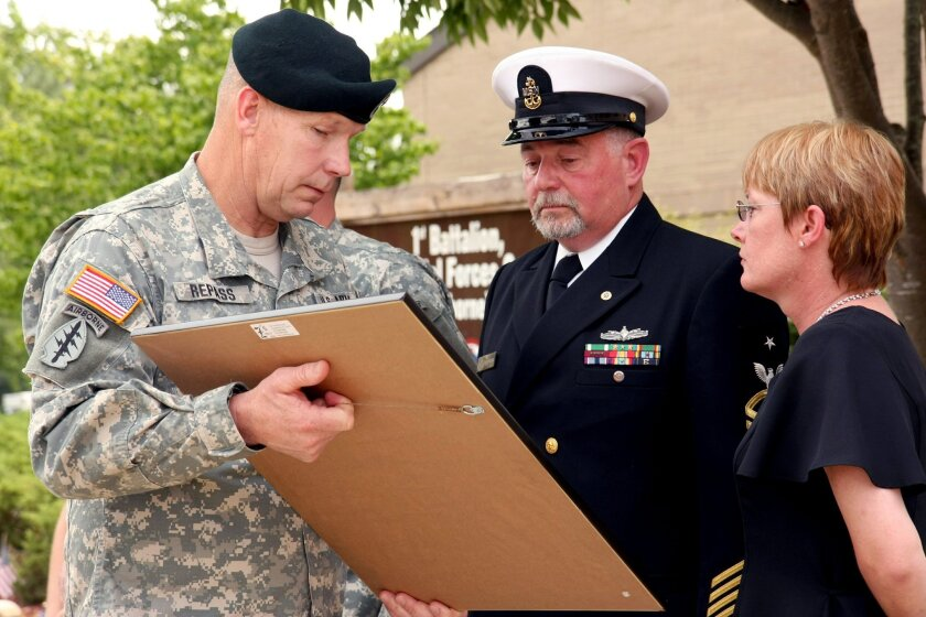 Brig. Gen. Michael Repass, commanding general of the Army Special Forces Command (Airborne), presented a collection of medals that the late Sgt. James Treber had received to Treber's father, Gordon Treber, on July 15, 2009. / photo courtesy of U.S. Air Force