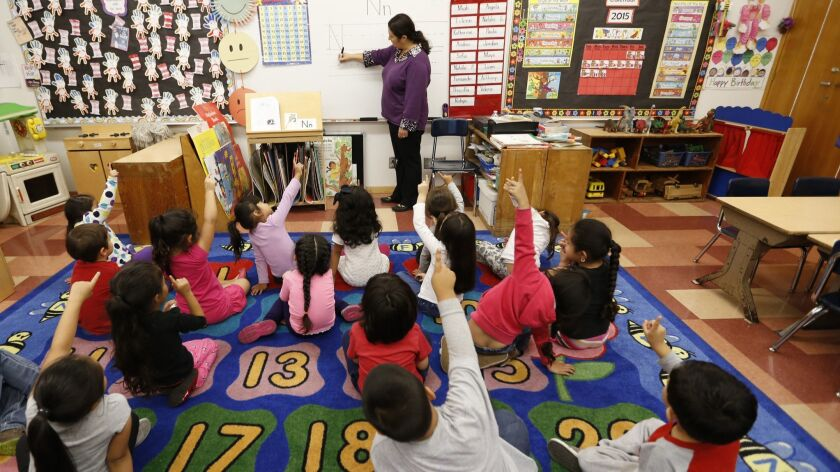LOS ANGELES, CA MAY 12, 2015 -- Teacher Celia Cendejas leads the Pre-K students in the School Rea