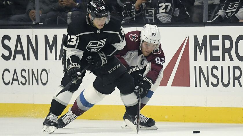 Kings right wing Dustin Brown (23) and Avalanche left wing Gabriel Landeskog battle for the puck during the second period Wednesday night.