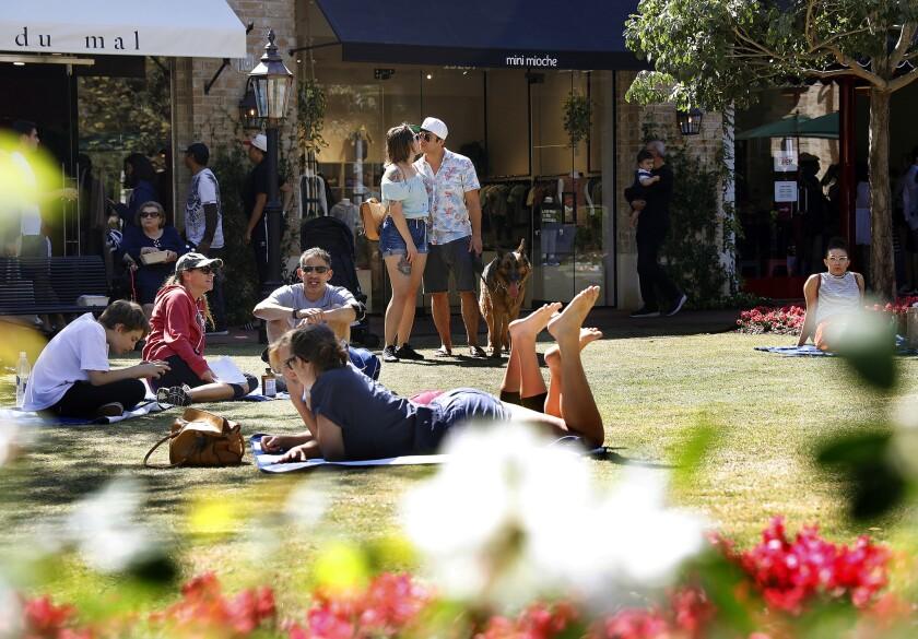PACIFIC PALISADES-CA-SEPTEMBER 23, 2018: Visitors enjoy a sunny day at Caruso's Palisades Village on