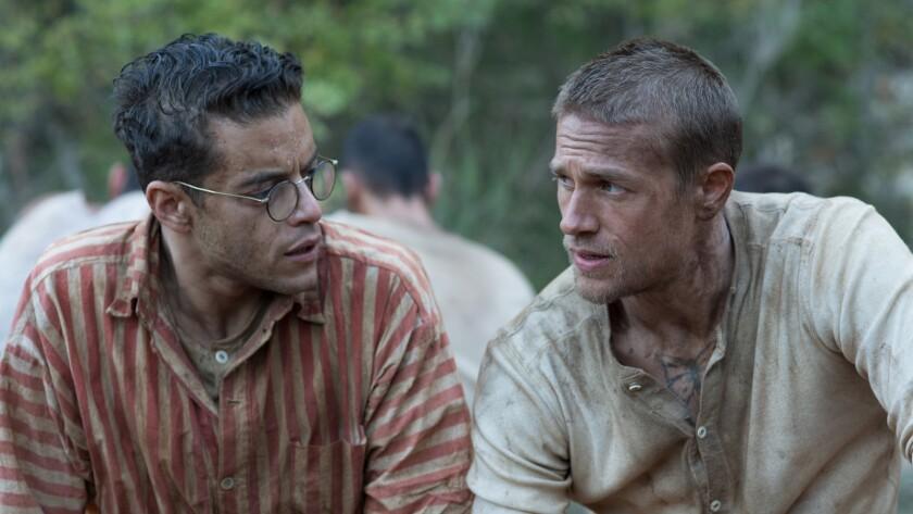"Rami Malek (left) stars as ""Louis Dega"" and Charlie Hunnam (right) stars as ""Henri 'Papillon' Charri"