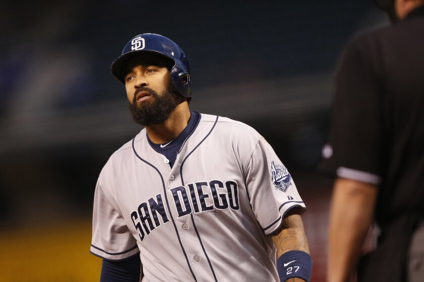 San Diego Padres' Matt Kemp (27) reacts after fouling off a pitch against Colorado Rockies starting pitcher Chad Bettis in the first inning of a baseball game Friday, Sept. 18, 2015, in Denver. (AP Photo/David Zalubowski)