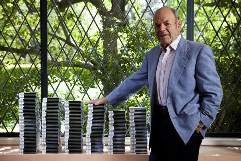 Joe Smith with discs containing hundreds of hours of interviews he conducted in the 1980s. He donated them to the Library of Congress in 2012.