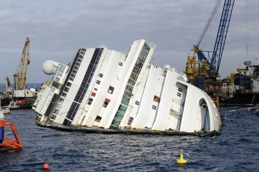 Year after wreck, salvage of Costa Concordia falls behind schedule