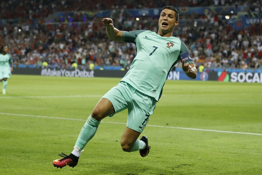 Portugal's Cristiano Ronaldo celebrates after scoring his side's first goal during the Euro 2016 semifinal soccer match between Portugal and Wales, at the Grand Stade in Decines-Charpieu, near Lyon, France, Wednesday, July 6, 2016. (AP Photo/Frank Augstein)