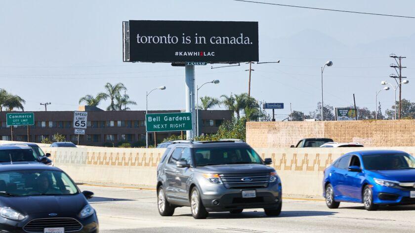 A Kawhi billboard in Commerce.
