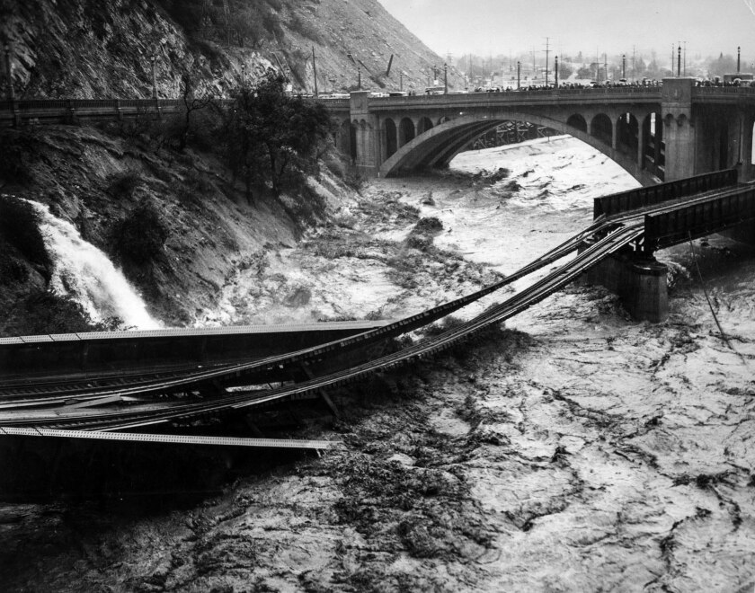 March 2, 1938: Los Angeles River floodwaters washed away a Southern Pacific railroad bridge. Photo taken from North Figueroa street bridge.