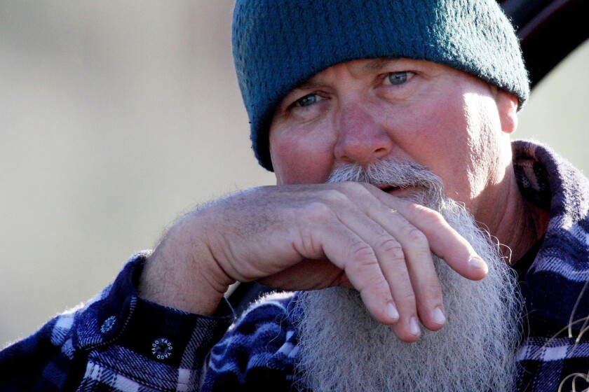 Russ Jack waits for the word about his missing daughter as the search for two missing teenage hikers enters another day.