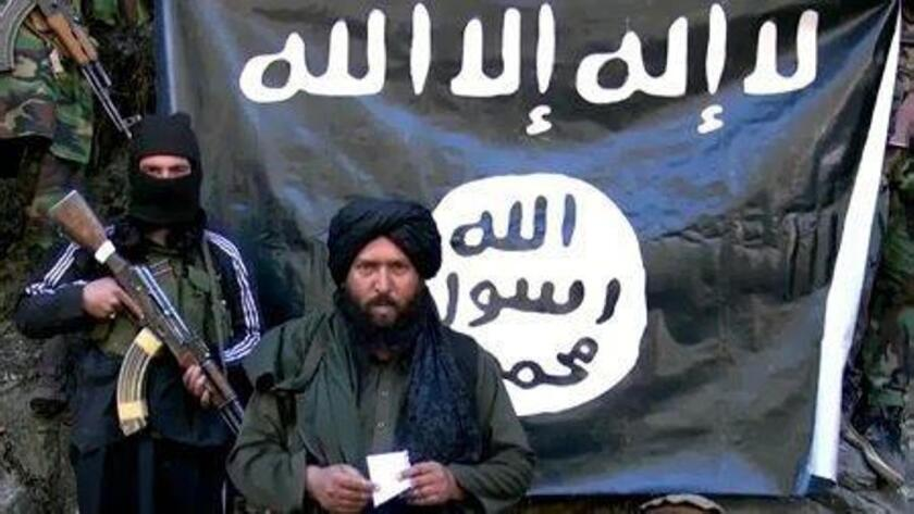 An image made from a video released by the Islamic State on Jan. 27, 2015, purportedly shows Hafiz Said Khan, center, leader of the group's branch in Pakistan and Afghanistan, at an undisclosed location along the two nations' shared border.