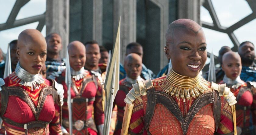 """Florence Kasumba, left, as Ayo and Danai Gurira, right, as Okoye wear costumes designed by Ruth E. Carter, who received her third Oscar nomination for """"Black Panther."""""""