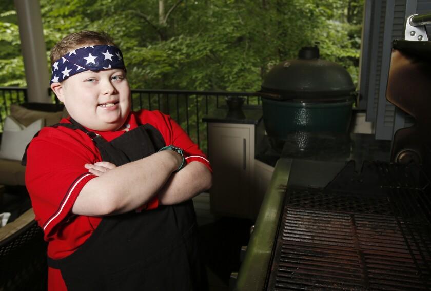 Fuller Goldsmith stands at one of three grills on his back porch in Tuscaloosa, Ala., in 2017.