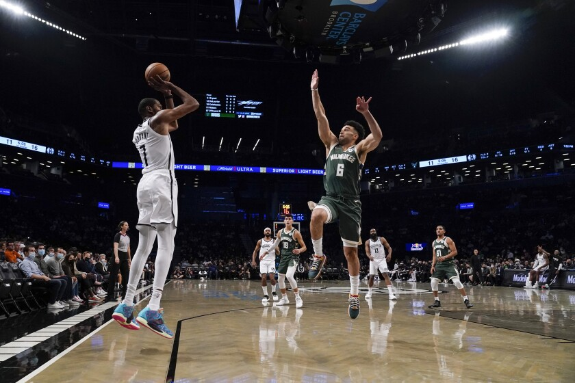 Brooklyn Nets' Kevin Durant (7) shoots over Milwaukee Bucks' Elijah Bryant (6) during the first half of a preseason NBA basketball game Friday, Oct. 8, 2021, in New York. (AP Photo/Frank Franklin II)