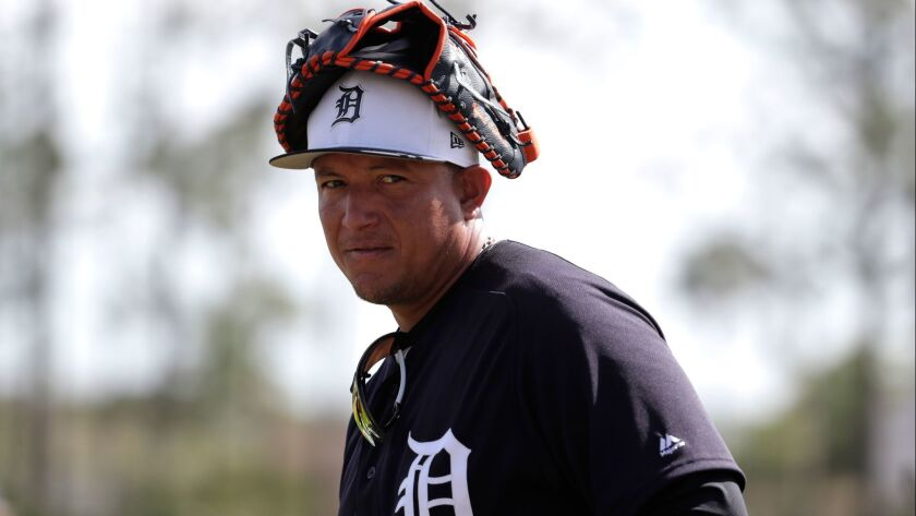 The Tigers' Miguel Cabrera walks on the field as the team does fielding drills at baseball spring training camp, Thursday, Feb. 22, 2018, in Lakeland, Fla.