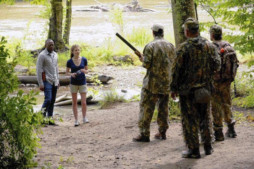 "Omar Epps and Devin Kelley star in ""Resurrection."""