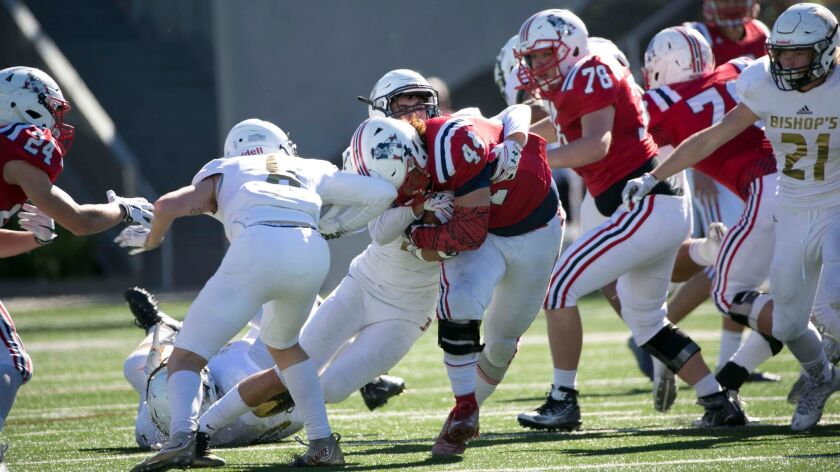 Bishop's defense gangs up to stop Christian running back Joey Morones. The Knights allowed the Patriots 280 yards total offense while Bishop's piled up 503 total yards in moving to 13-0 this year.