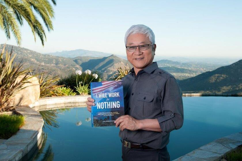"Charlie Yim with his memoir ""I Will Work for Nothing."""