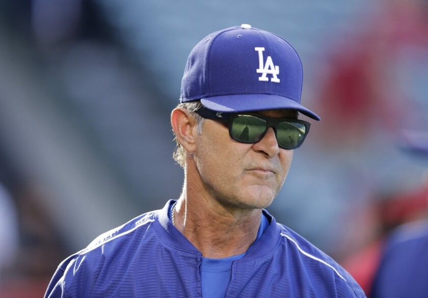 Dodgers Manager Don Mattingly has fond memories of Yogi Berra, whose No. 8 Mattingly adopted as his own when he joined the Dodgers.