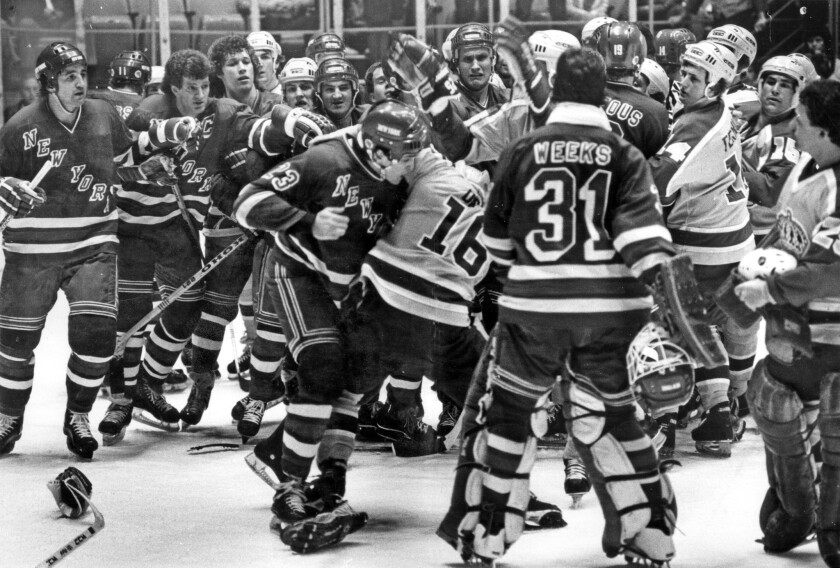 New York Rangers defenseman Ed Hospodar fights with Kings great Marcel Dionne during the first period of Game 2 in the preliminary round of the 1981 Stanley Cup playoffs. There were 15 separate fights and a playoff record for penalties in Kings' 5-4 victory.