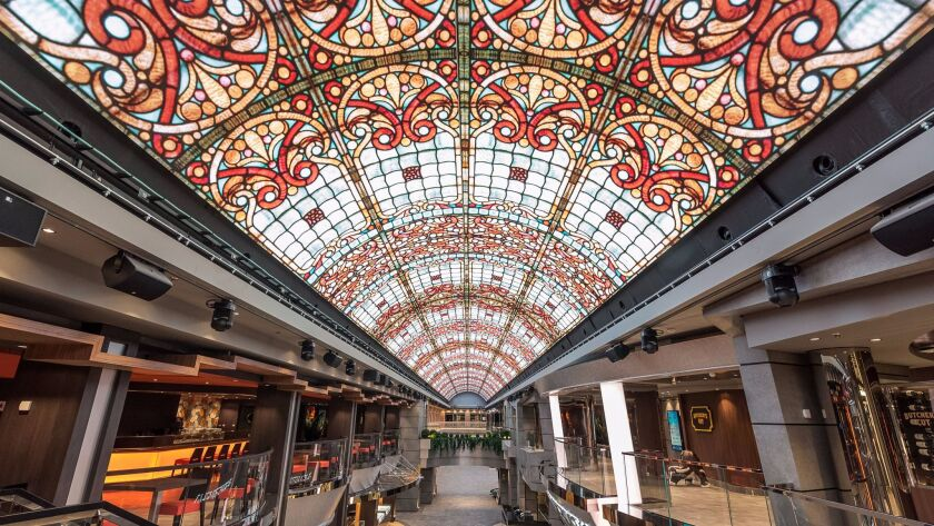 The ship's Mediterranean-style indoor promenade features a 262-foot LED sky that creates different v