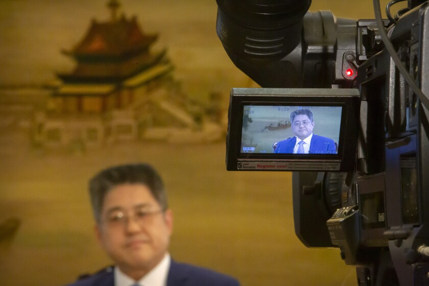 Chinese Vice Minister of Foreign Affairs Le Yucheng listens to a question during an interview with the Associated Press at the Ministry of Foreign Affairs in Beijing, Friday, April 16, 2021. Le spoke to AP on a wide range of issues during an interview on Friday including climate change and US-China relations. (AP Photo/Mark Schiefelbein)