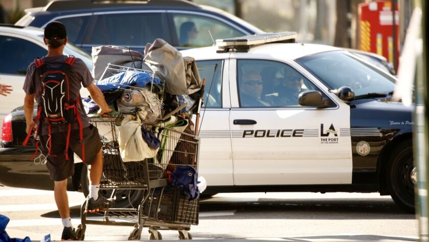 LOS ANGELES CA JULY 1, 2019 -- Homeless people pack up their belongings along First Street between