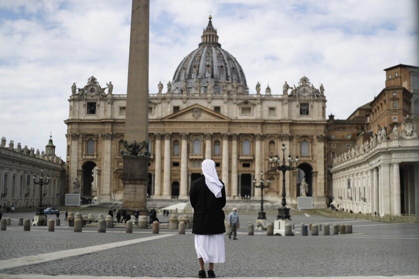 FILE - In this Sunday, March 21, 2021 filer, a nun stands in St. Peter's Square at the Vatican. Vatican prosecutors have alleged a jaw-dropping series of scandals in launching the biggest criminal trial in the Vatican's modern history, which opens Tuesday in a modified courtroom in the Vatican Museums. The once-powerful cardinal and nine other people are accused of bleeding the Holy See of tens of millions of dollars in donations through bad investments, deals with shady money managers and apparent favors to friends and family. (AP Photo/Gregorio Borgia, File)
