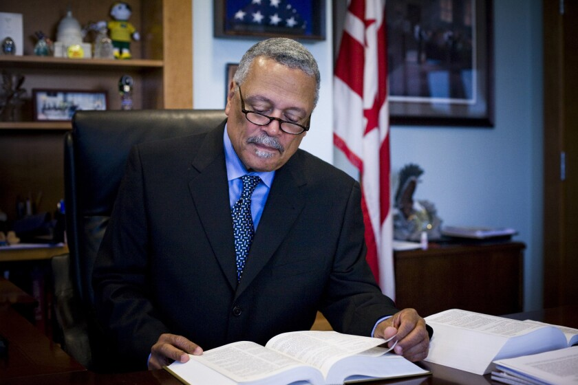 U.S. District Judge Emmet G. Sullivan appears skeptical of Atty. Gen. William Barr's decision to drop the case against Michael Flynn.