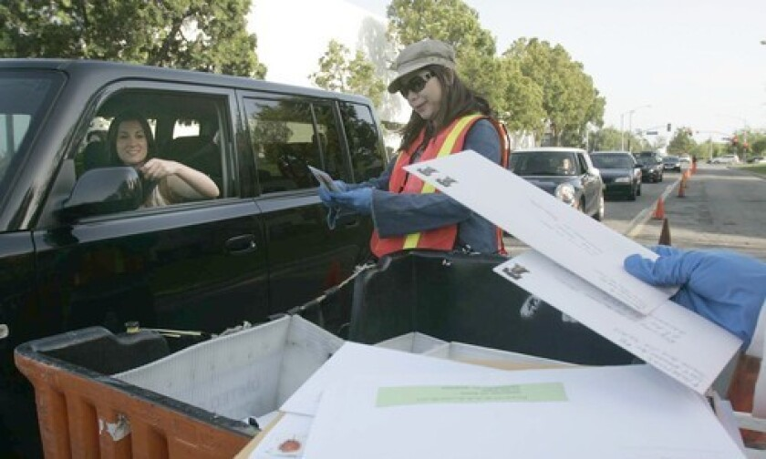 Drivers line up to mail tax returns last year at a Santa Ana post office.