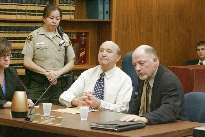 Henry Lisowski (center), with his attorney, Richard Gates, was found guilty yesterday of first-degree murder with special circumstances in the death of his wife, even though no body was ever found.