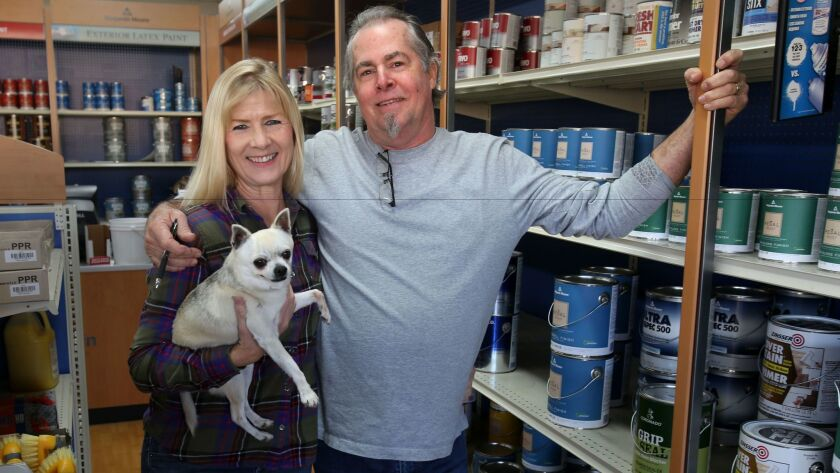 Kim and Mark Olinger, with their dog Daisy, are closing their family-owned paint store in Vista, Dura Paint, after 58 years, in order to retire. Mark's father and grandfather bought the downtown Vista building in 1958.