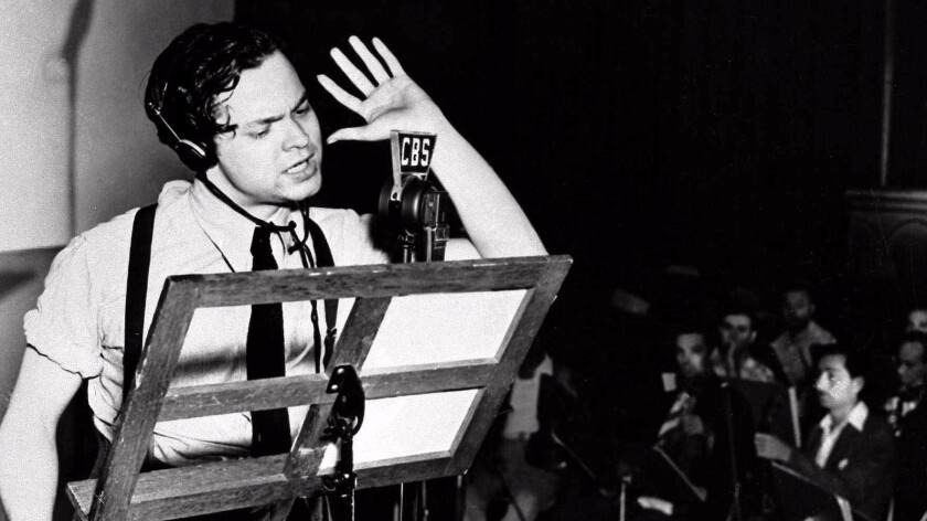Orson Welles reads from his War of the Worlds script on Oct. 30, 1938.